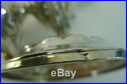 Antique/vintage silver pair of highly detailed fish shaped candle stick holders